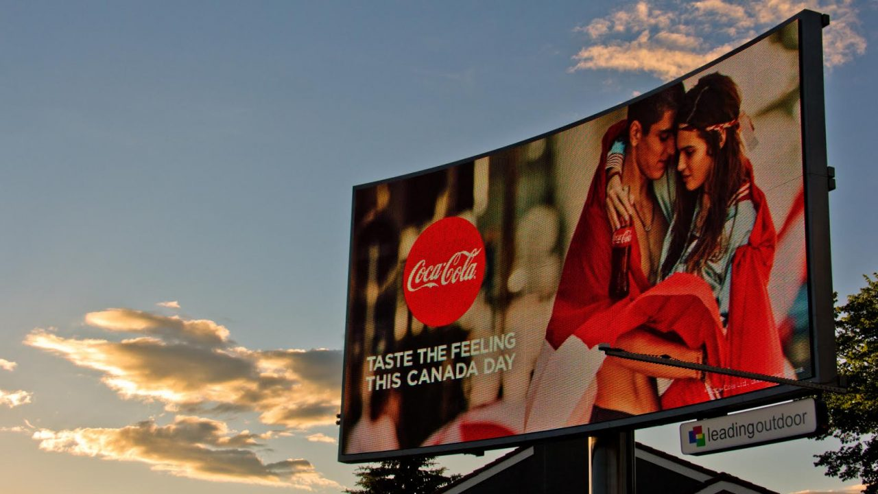 Coca Cola ad on a curved LED board in Calgary