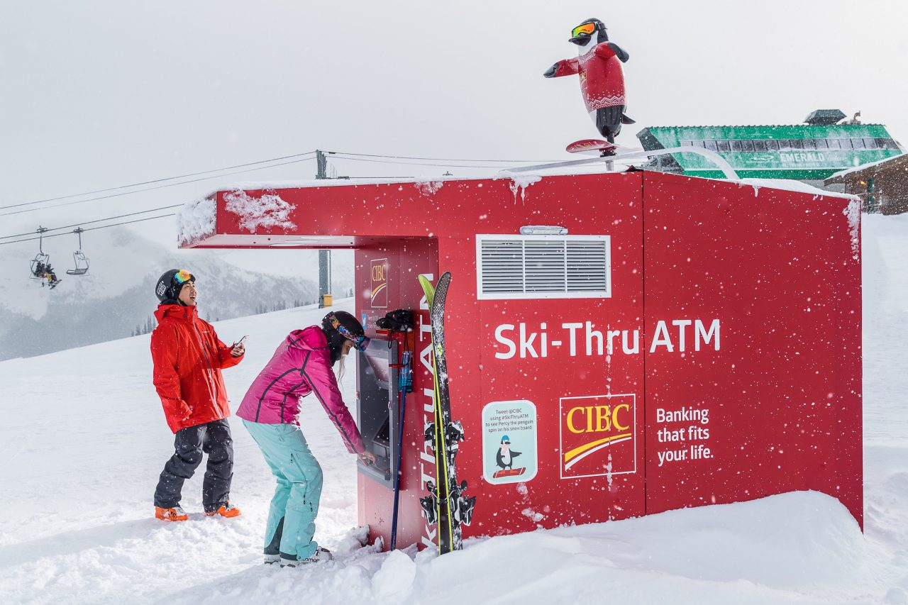 The world's only ski-thru ATM in Whistler BC topped with a 3D printed penguin mascot for CIBC