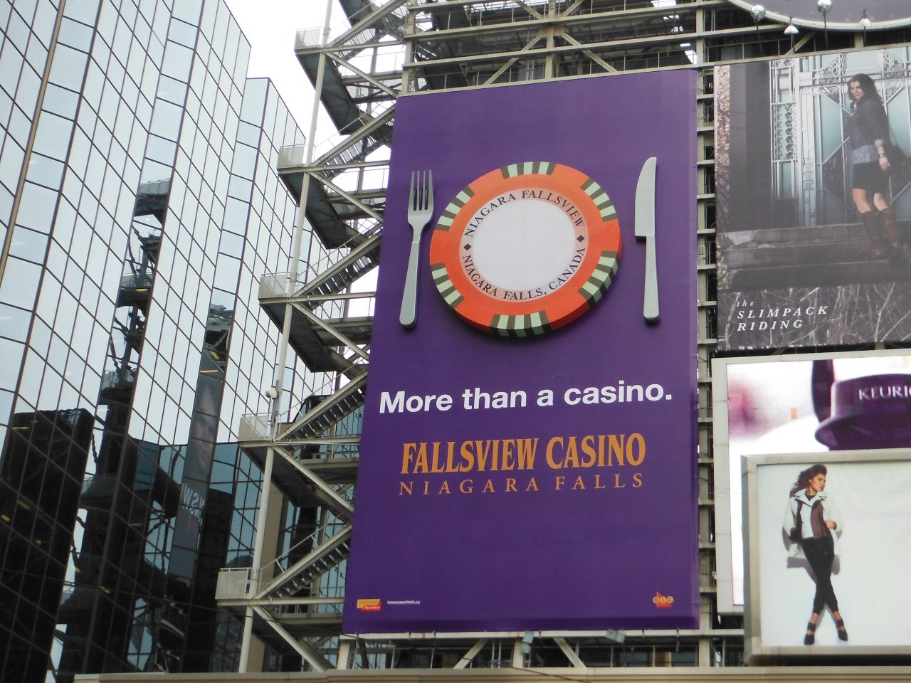 "Fallsview Casino billboard with 3D extension shows gambling chip as dinner plate, ""more than a casino"""