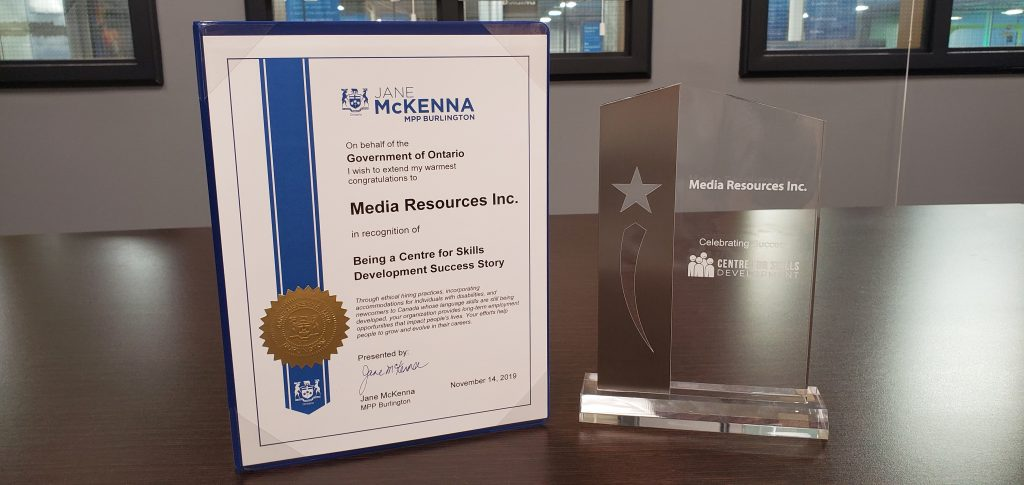 Plaque and glass trophy awarded to Media Resources for being a Centre for Skills Development success story