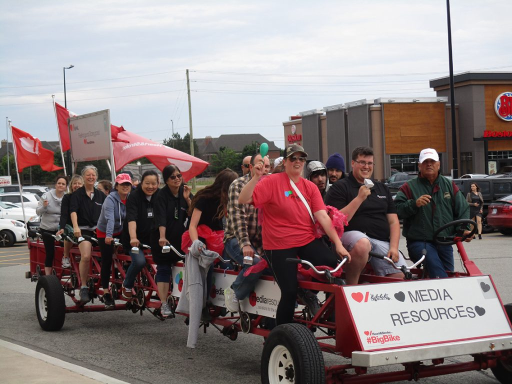 Media Resources' bike bike for the heart and stroke charity being driven by a dozen employees
