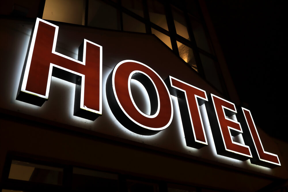 View of Glowing Hotel Sign at Night