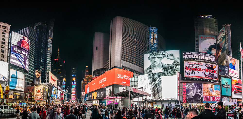 Crowded Times Square High Resolution Panorama at Night and LED Advertising Lighting up the Place in Manhattan, New York
